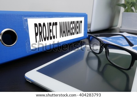 PROJECT MANAGEMENT Office folder on Desktop on table with Office Supplies. ipad - stock photo