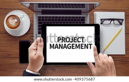 PROJECT MANAGEMENT, on the tablet pc screen held by businessman hands - online, top view - stock photo
