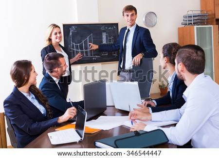 Project manager congratulating work superintendent with very successful results in office  - stock photo