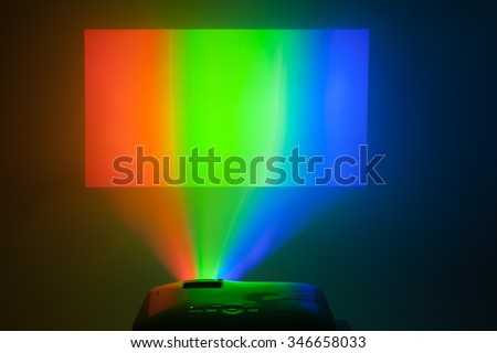 projector in action with illuminated rgb screen - stock photo