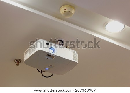 Projector on ceiling close - stock photo