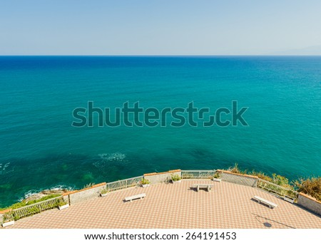 Promenade with benches overlooking the Tyrrhenian sea, Calabria, South Italy. - stock photo