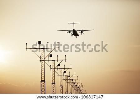 Propeller airplane is landing on Prague Airport, Czech Republic - stock photo