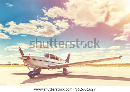 Propeller plane parking at the airport. Sunny day. - stock photo