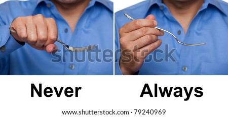 Proper way to hold a fork concept - stock photo