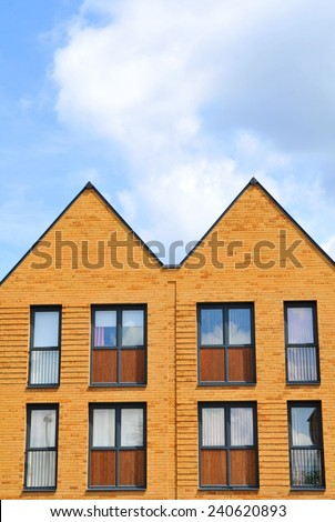 Property development concept with newly built houses against blue sky - stock photo