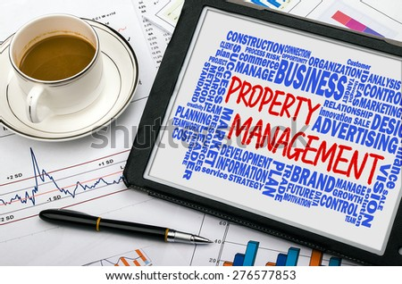 property management concept with related word cloud handwritten on tablet pc - stock photo