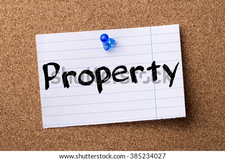 Property - teared note paper pinned on bulletin board - horizontal image - stock photo