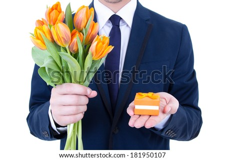 proposal - man holding gift box with wedding ring and flowers isolated on white background - stock photo