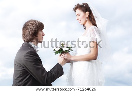 Proposal of marriage. Young couple portrait. - stock photo