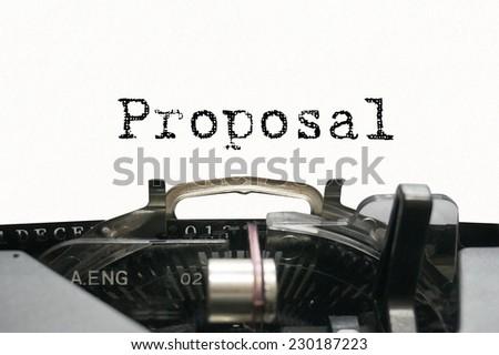 Proposal on typewriter - stock photo