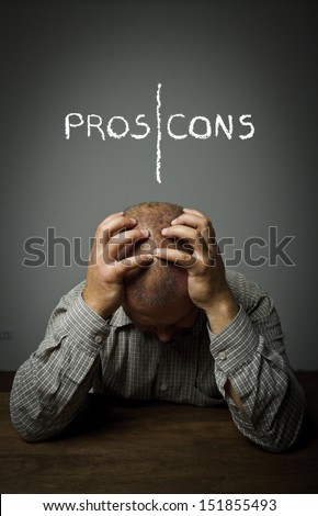 Pros and cons. Man in thoughts. Expressions, feelings and moods. - stock photo