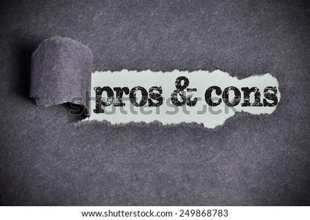 pros & cons word under torn black sugar paper  - stock photo
