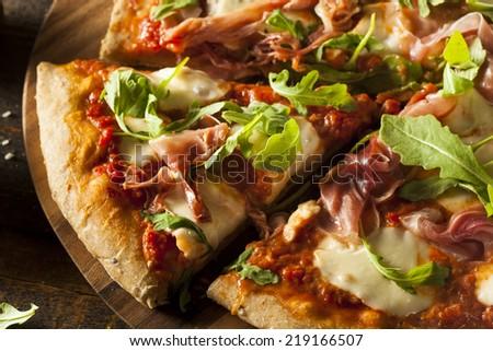 Prosciutto and Arugula Pizza with Marinara Sauce - stock photo