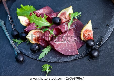 Prosciutto crudo with arugula and figs - stock photo
