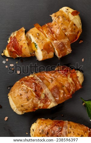 Prosciutto Wrapped Chicken. Selective focus. - stock photo