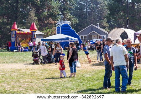 Prospect, Oregon - August 15: Families and friends gathering around the attractions at the Jamboree and Timber Carnival, August 15 2015 in Prospect, Oregon - stock photo