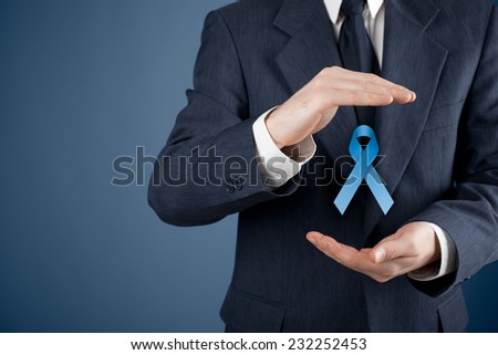 Prostate cancer awareness, peace and genetic disorder awareness - man with protective and support gesture and blue ribbon. - stock photo