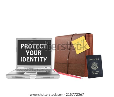 Protect Your Identity on laptop screen next to file folder pen and US passport isolated on white background - stock photo