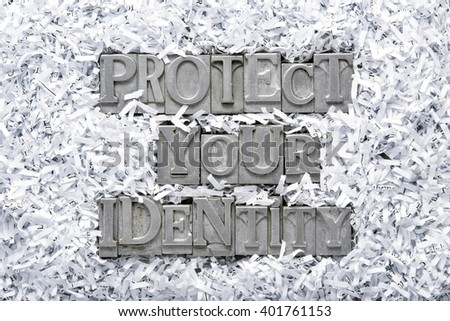 protect your identity phrase made from metallic letterpress type inside of shredded paper heap - stock photo