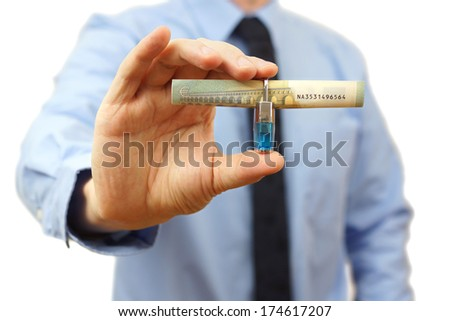 protect your money concept with banknote and padlock - stock photo