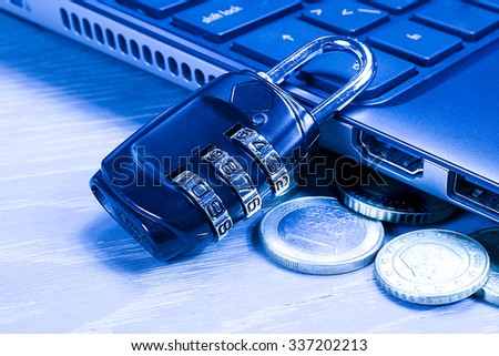 Protection concept: padlock, computer keyboard and money coins. Blue tone. - stock photo