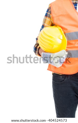 Protection equipment or uniform concept with engineer holding yellow helmet and wearing gloves and vest isolated on white - stock photo