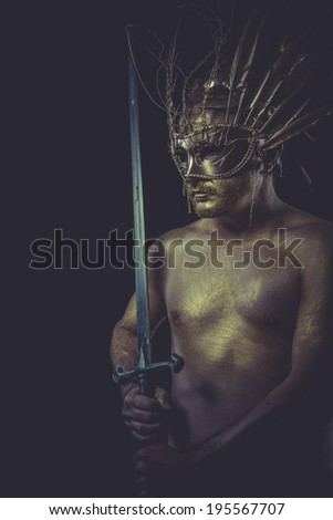 Protection, golden deity, man with wings and gold helmet - stock photo