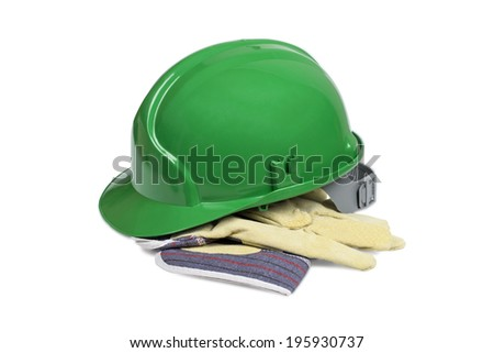 Protection helmet and gloves isolated over white with clipping path. - stock photo