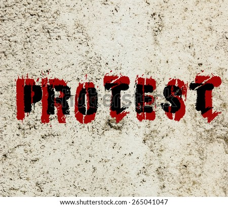 Protest message graffiti painted on a concrete wall  - stock photo