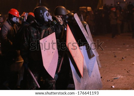 Protesters in masks with accounts ready to fight. Kyiv, Ukraine, January 19, 2014 - stock photo