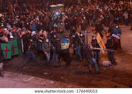 Protesters pull rope. Kyiv, Ukraine, January 19, 2014 - stock photo