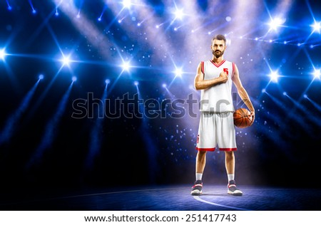 Proud basketball player is praying befor the mach - stock photo