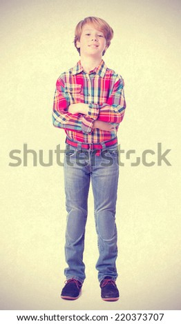 Proud child with arms crossed - stock photo