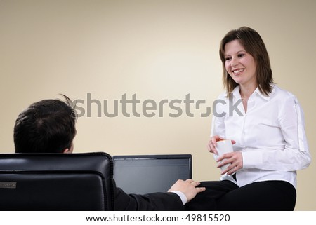 proud manager communicating with chairman - stock photo