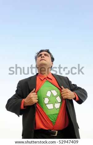 proud to recycle: businessman is a recycling hero - stock photo