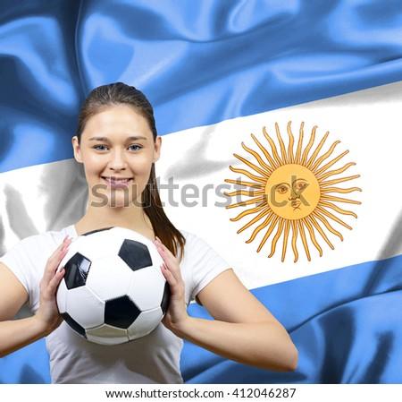 Proud woman football fan of Argentina - stock photo
