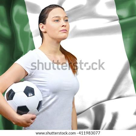 Proud woman football fan of Nigeria - stock photo