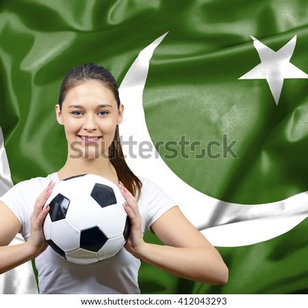 Proud woman football fan of Pakistan - stock photo