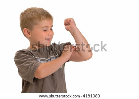 Proud young boy feeling his muscle on his arm, isolated on white - stock photo