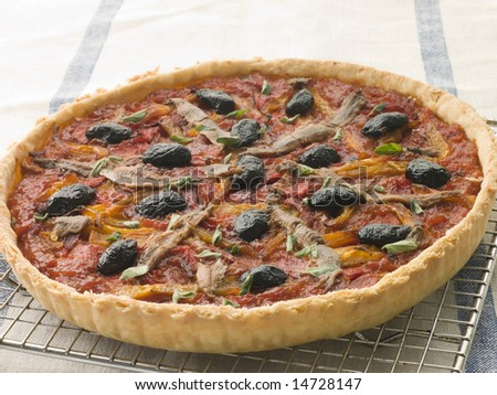 Provencale Tart on a Cooling Rack - stock photo