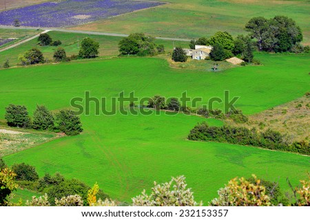 Provence rural landscape. View from above on the fields and farmhouses near village of Sault - stock photo