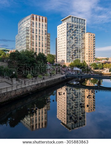 PROVIDENCE, RHODE ISLAND - JULY 24: Waterplace Park, the Woonasquatucket River and condominiums from the Martin Luther, Jr. Bridge in Providence, Rhode Island on July 24, 2015. - stock photo