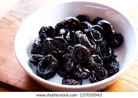 Prunes in Dish - stock photo