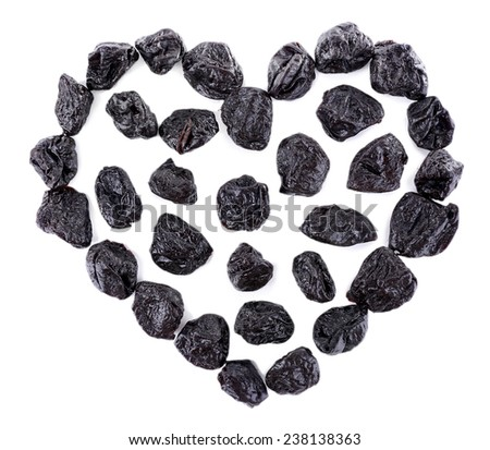 Prunes in form of heart isolated on white - stock photo