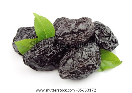 Prunes on a white background - stock photo