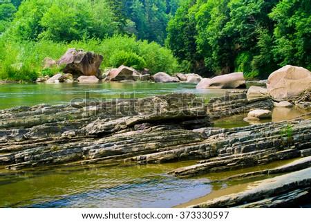 Prut Riverbank in Ukraine. Yaremche, Carpathians. - stock photo