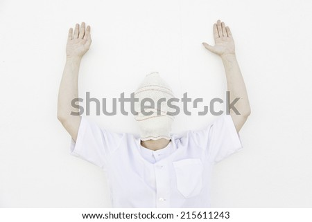 Psychiatric patient bandaged with mental disorders - stock photo
