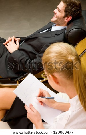 psychiatrist examining a male patient - stock photo