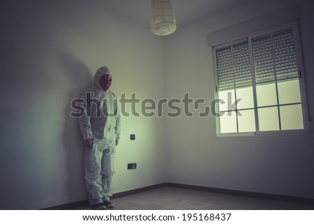 Psychiatrist, nightmare man with red mask in empty room - stock photo